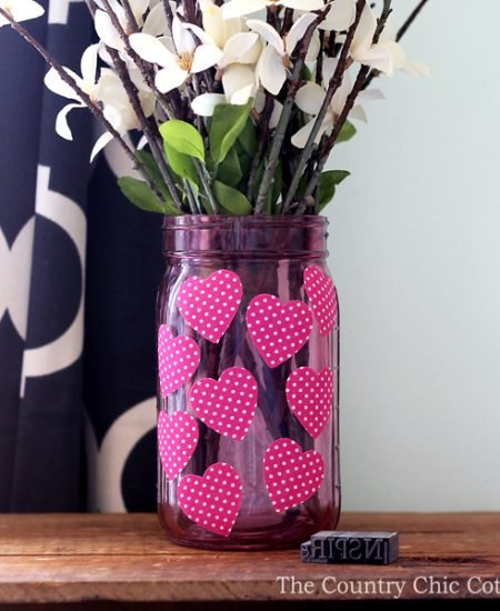 Make this Valentine's mason jar for your Valentine's Day decor! A fun mason jar craft that is perfect as a vase or to give a Valentine's gift. Plus you can make this one in 15 minutes or less!