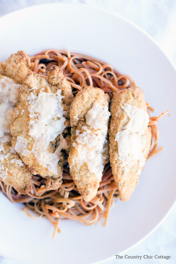 Make this 30 minute chicken parmesan recipe for your family! This quick and easy recipe is perfect for a week night meal!
