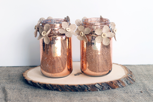 This copper mason jar centerpiece is perfect for weddings and other events! You can make this in minutes and the burlap flowers really add a rustic touch!