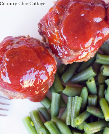 Make these mini cheddar meatloaves in a muffin tin! A great way to eat meatloaf! Plus this meatloaf recipe is delicious with a zesty sauce on the top!