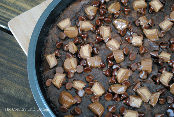Make these skillet peanut butter cup brownies for a fabulous dessert! If you love chocolate and peanut butter together, this one is for you!
