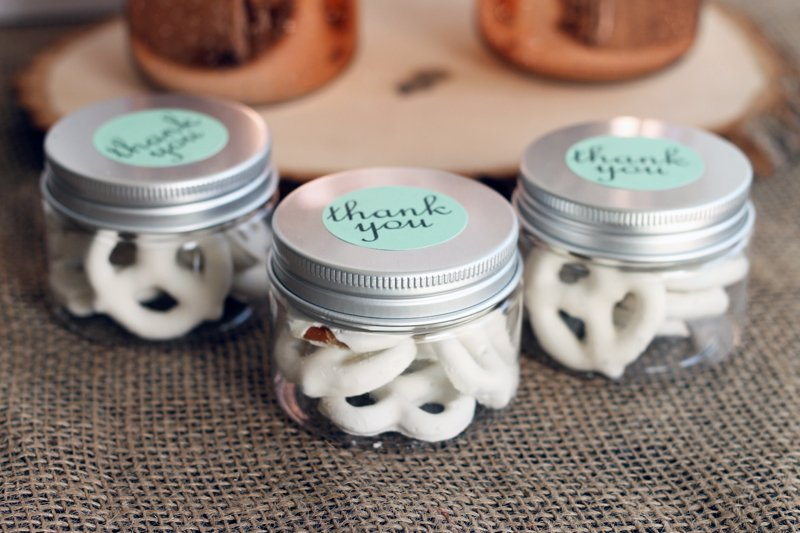 these wedding favors in small mason jars are perfect for your wedding the jars are