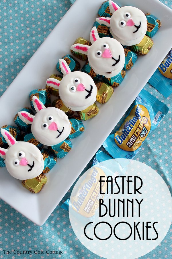 five easter bunny cookies with butterfinger candies on serving platter