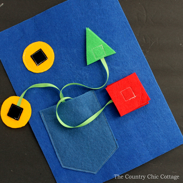 Make your own shapes busy book page! A busy book is a great handmade gift for babies and toddlers!