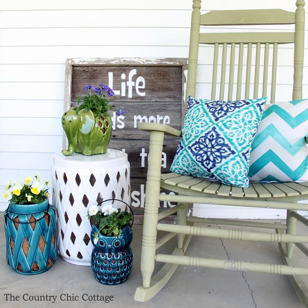 porch rocker with pillows on a porch