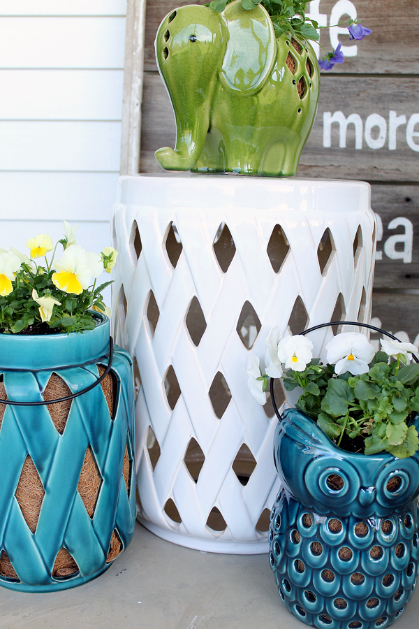 white ceramic stool used as a side table for plants