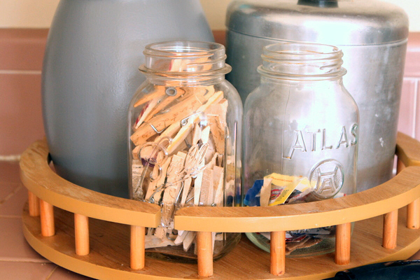 Paint this farmhouse utensil holder with just a crock from the thrift store and a few paints!