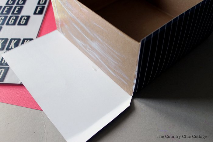 Simply use mod podge to decorate a simple cardboard box to collect the recipe cards
