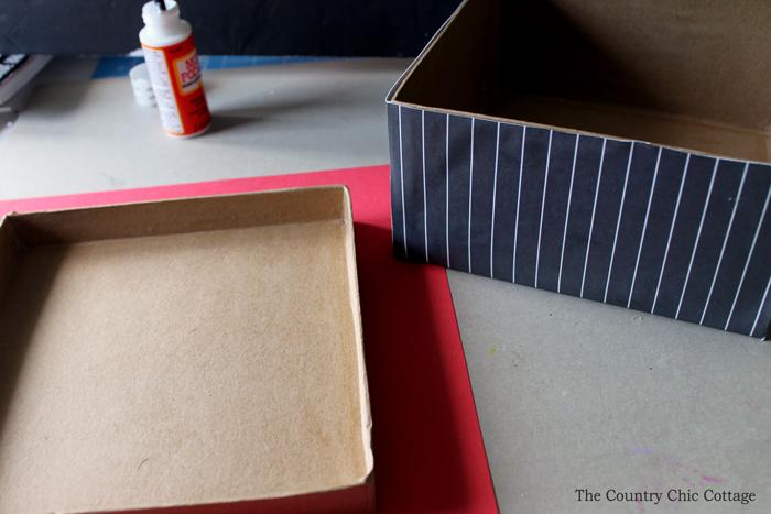 Cover a plain box in crafting paper to create a recipe card box