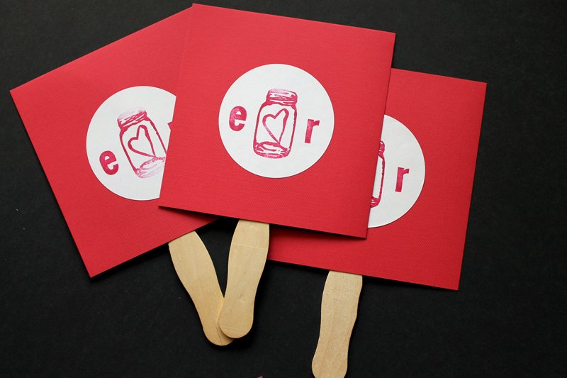 Make your own DIY wedding fans to hand out to your wedding guests! Perfect for a wedding ceremony in the summer!