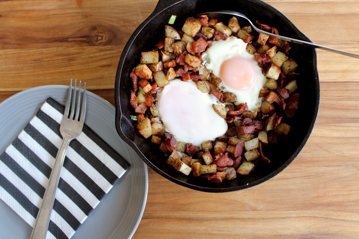 This breakfast skillet is made with fried eggs, potatoes, bacon, and delicious veggies