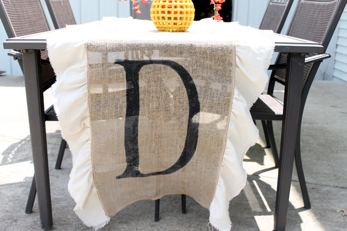 Make this DIY burlap table runner with monogram for your home! I love the simple ruffles on the side as well!