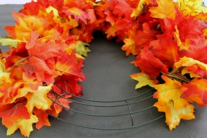 add fall leaves to a wreath