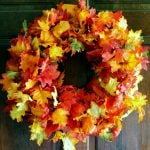 Add this fall wreath to your front door! It is quick and easy to make with one secret supply!