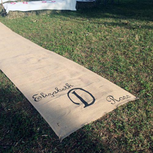 burlap aisle runner in grass