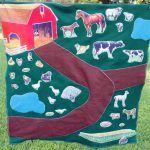 Make this DIY farm play mat for any child! A sewing project that makes a great gift idea for kids!
