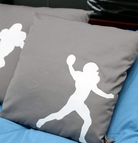 Make these DIY football silhouette pillows with a few simple supplies! A quick and easy project that is perfect for a boy's room!