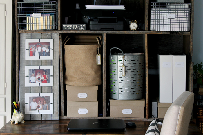 Make the most out of your desk storage hutch with eclectic baskets, picture frames, and boxes to help organize your work space