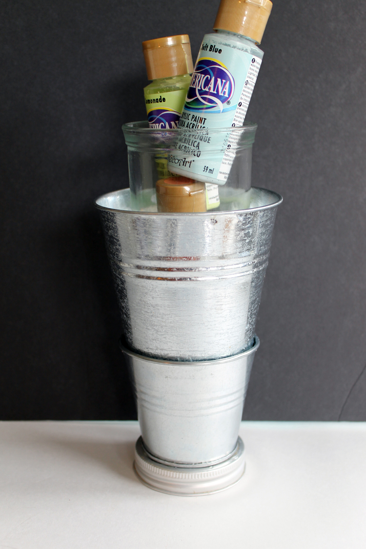 acrylic paints and metal pails