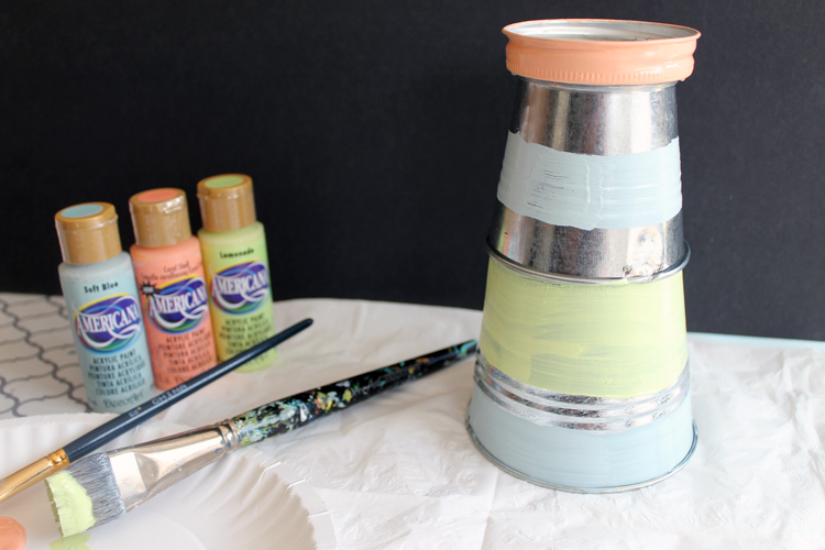 painting pails and mason jar lids for garden lighthouse