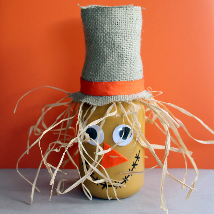 Make this scarecrow jar fall craft idea for your autumn home! A fun craft that the kids will love to help with!