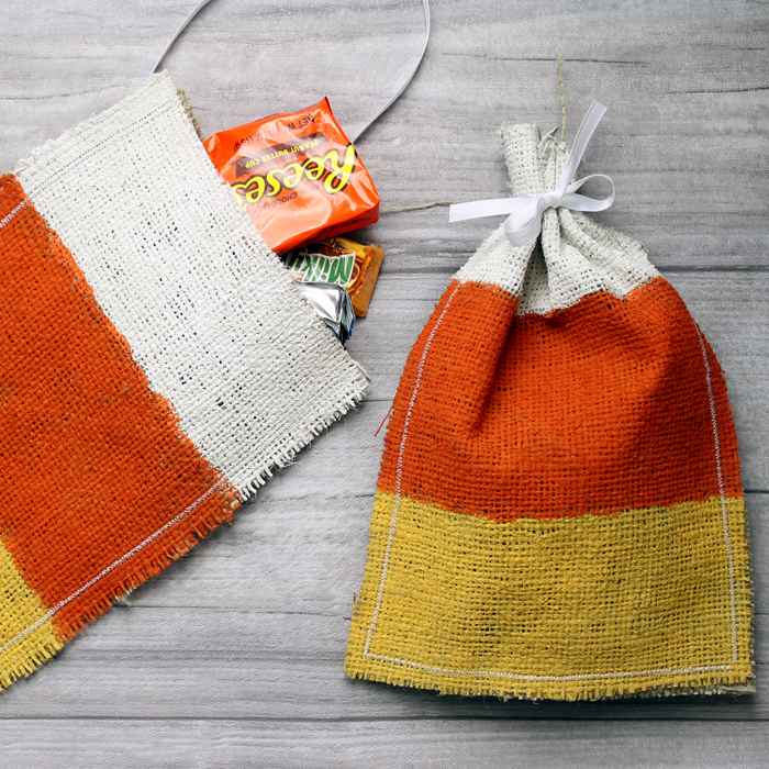 Make these candy corn Halloween treat bags from burlap in just minutes! Great step by step instructions!