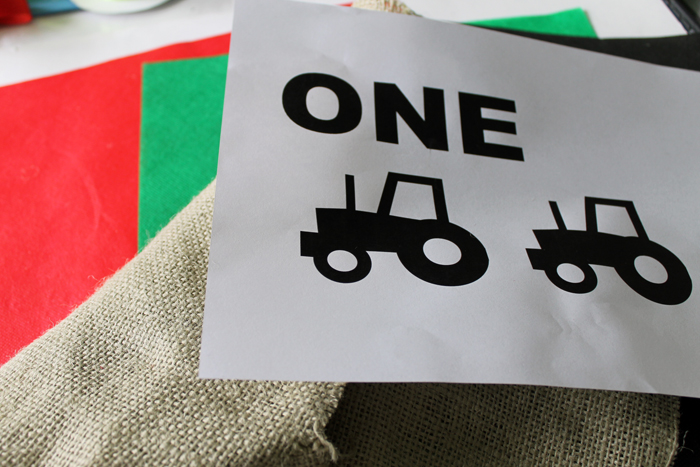 Print out the ONE and tractor graphics for the highchair birthday banner