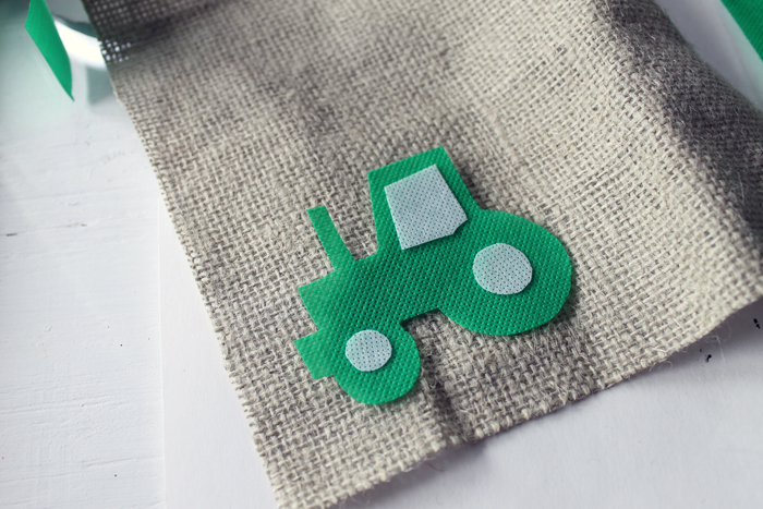 Making the tractor themed highchair birthday banner