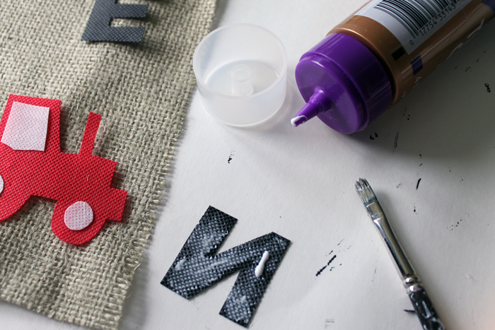 How to glue letters onto your tractor themed first birthday banner