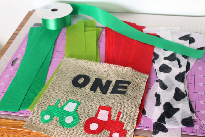 We're making a first birthday highchair banner using ribbon and burlap!