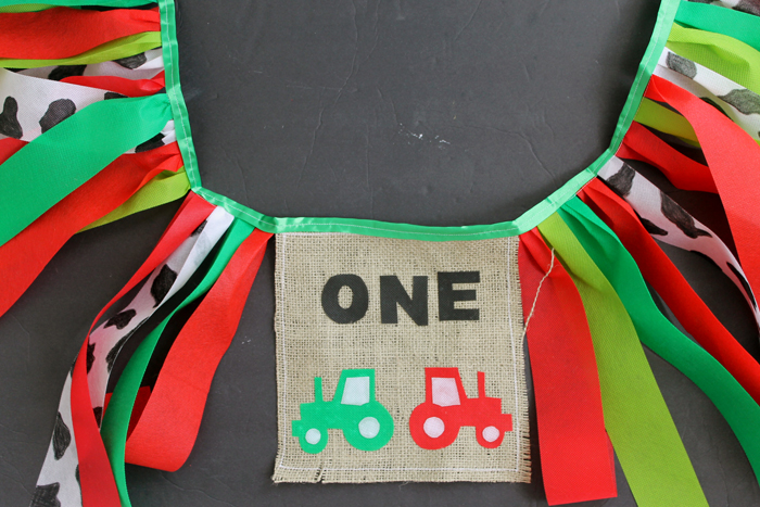 This farm themed first birthday banner is ready for the birthday baby's highchair!