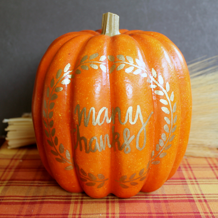 front view of pumpkin with gold drawing