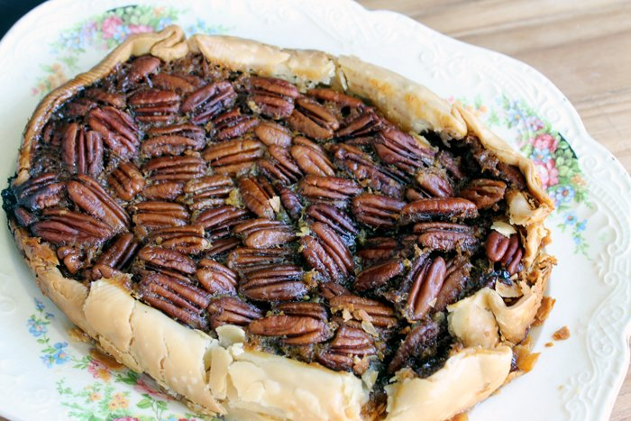 Make this crock pot pecan pie recipe any day of the week! Perfect for Thanksgiving when your oven is full!