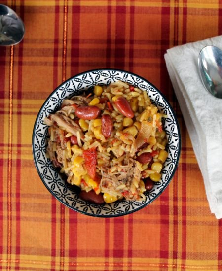 This jerk pork rice bowl is the perfect crock pot meal for winter! Get out that slow cooker!