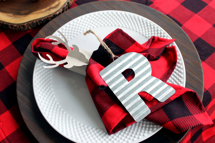 plaid napkins on white plates with letter R ornament