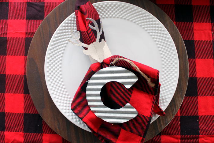 plaid napkins on white plates with letter C ornament