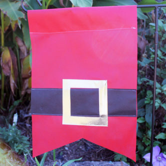 Make a Santa garden flag for your outdoor Christmas decor!