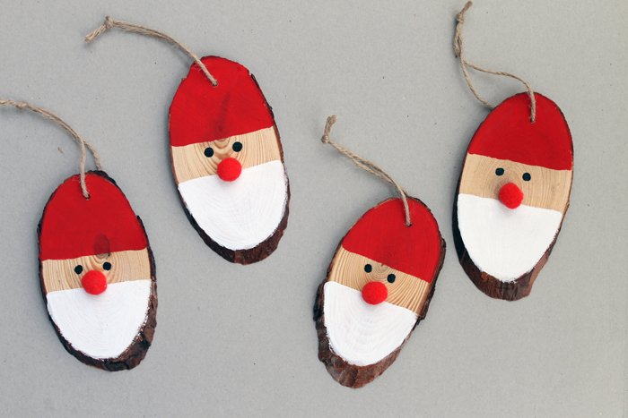 4 Santa DIY wooden ornaments on a table