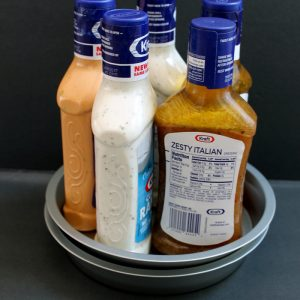 Dollar store lazy susan organizing idea - an inexpensive way to organize your kitchen cabinets!