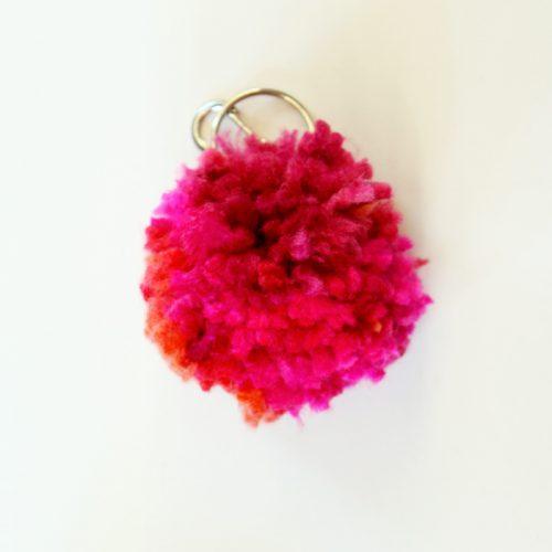 Learn how to make a pom pom key chain with a pom pom maker!