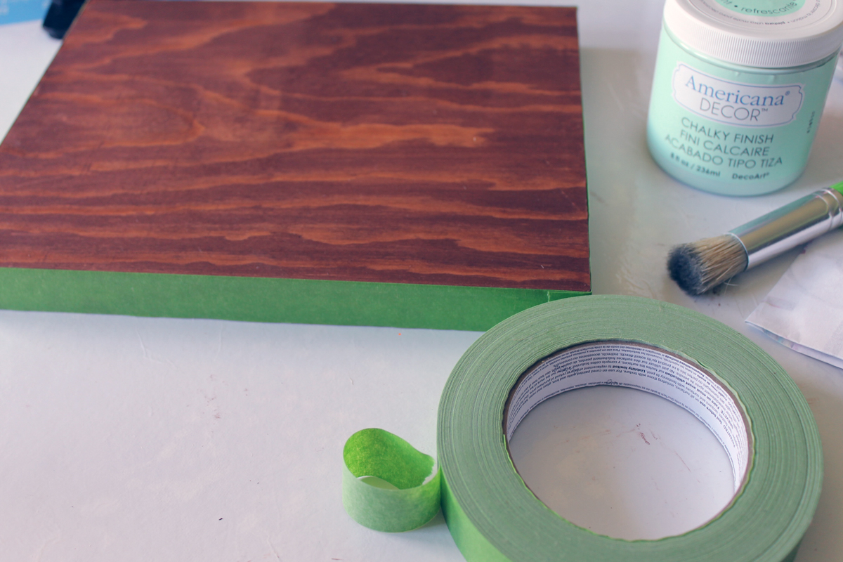Add painters tape to the edges of the panel before adding your pattern