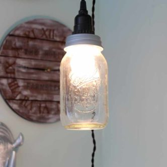 How to make a mason jar light in just minutes! A super easy tutorial for a pendant light!