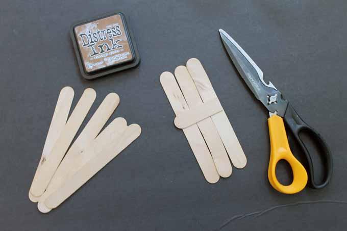 craft sticks, scissors, and ink pad