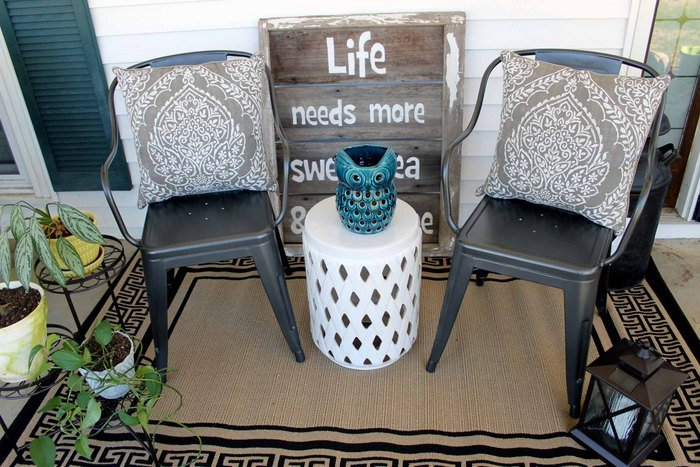 metal chairs outdoors on a porch