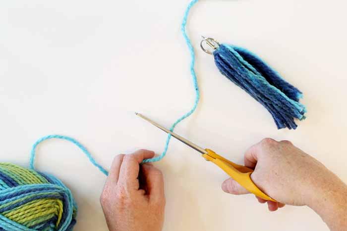 cutting piece of yarn
