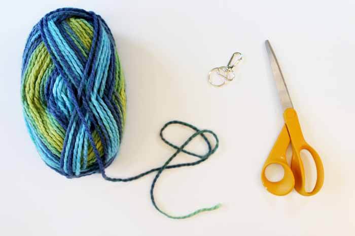 Craft supplies needed to make a tassel keychain