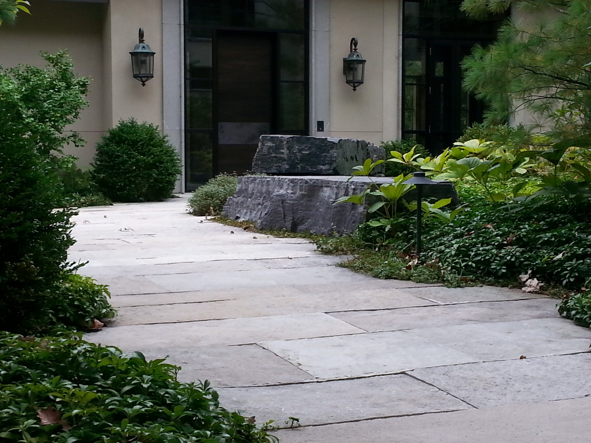 Natural stone landscaping adds a certain something to your home! Get tons of ideas here!