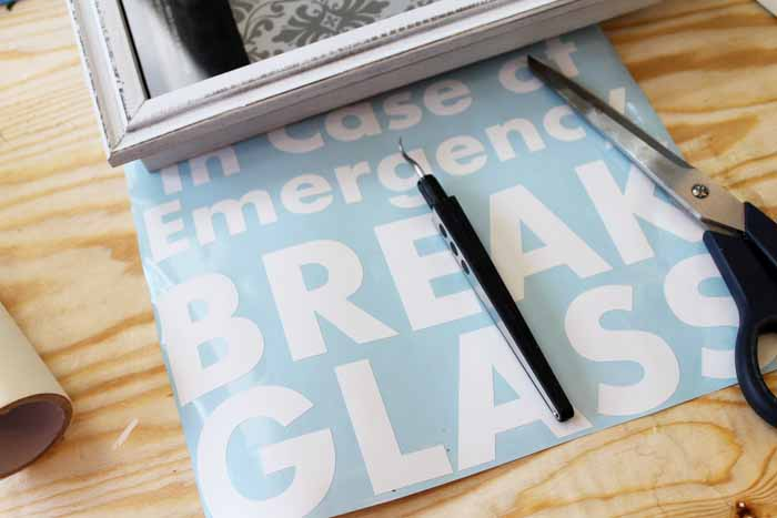 Using your Cricut, cut the shawdowbox lettering from a vinyl sheet.