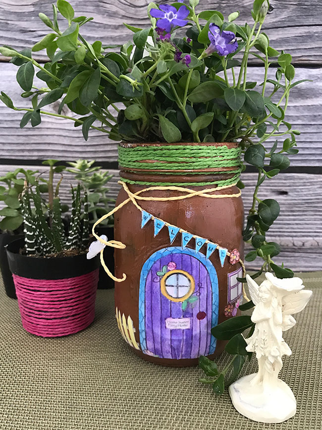 Make this mason jar fairy house this spring! Great free printable fairy garden coloring page as well!