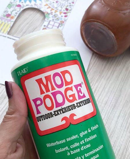 A close up of a bottle of Mod Podge